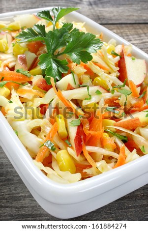 Salad with fresh cabbage,corn,apple and carrots