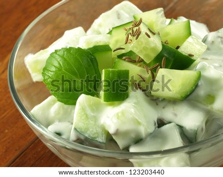 Salad with fresh cucumber and yogurt served in bowl