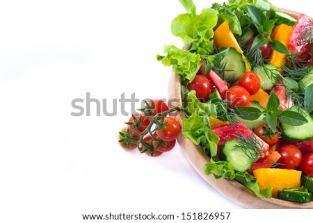 salad with fresh cucumbers and tomatoes on a white background