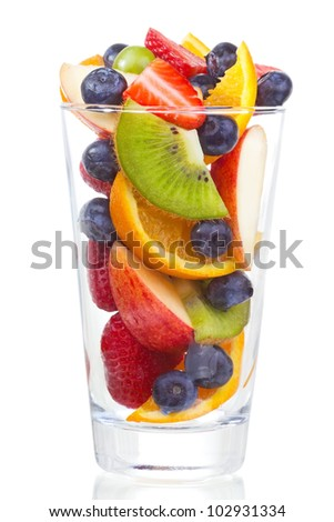 salad with fresh fruits and berries in glass on white background - stock photo