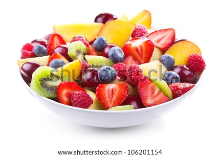 salad with fresh fruits and berries on white background - stock photo