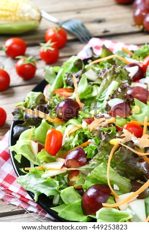 salad with fresh organic vegetables and fruit on the top view