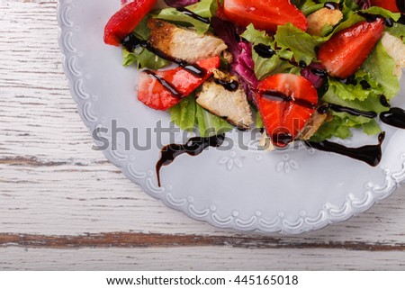 Salad with fresh strawberries,herbs and chicken meat,tossed with balsamic vinaigrette. Healthy food or diet concept.selective focus. - stock photo
