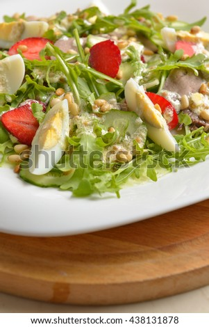 salad with fresh strawberries, pine nuts and egg