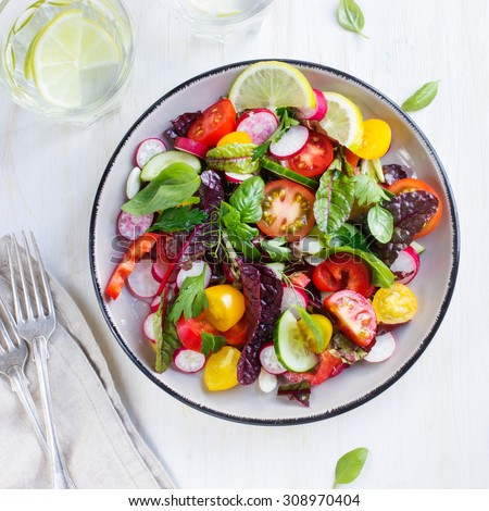 Salad with fresh summer vegetables, top view, square image - stock photo