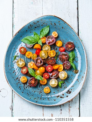 Salad with fresh tomatoes and basil - stock photo
