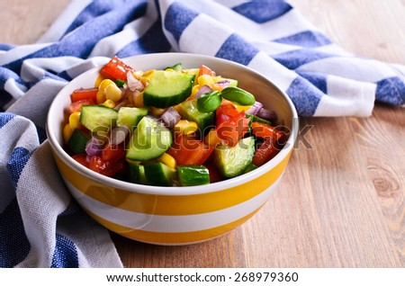 Salad with fresh vegetables in a ceramic dish - stock photo