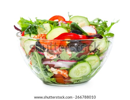 Salad with fresh vegetables, olives and shrimp in a glass bowl isolated on white background - stock photo