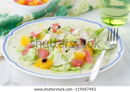 Salad with grapefruit, oranges, lettuce and cheese on a plate
