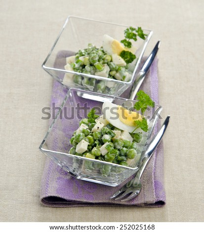 salad with green pepper sauce in glass egg salad on a linen napkin - stock photo