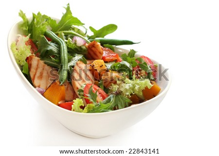 Salad with grilled chicken breast, mixed greens, roasted vegetables, tomatoes, beans, capsicum, onion, pumpkin.  Delicious healthy eating. - stock photo
