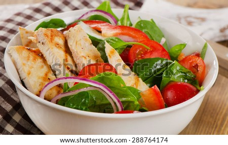 Salad with grilled chicken in  bowl. Selective focus