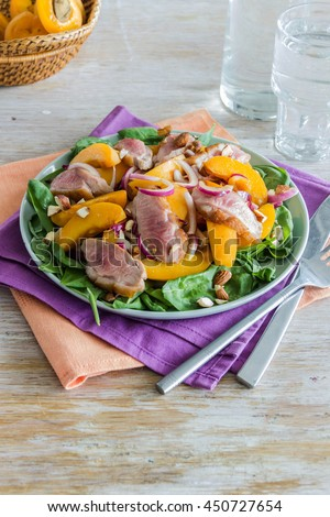 Salad with ham,apricots and Basil - stock photo