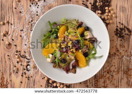 salad with herbs chicken breast and oranges. healthy food. top view.