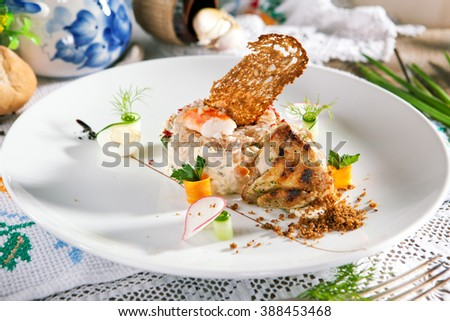 Salad with King Red Crab and Vegetables. Garnished with Grilled Wachtel - stock photo