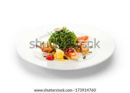 Salad with King Red Crab, Shrimps, White Asparagus, Poached Quail Eggs, Rucola and Truffle - stock photo