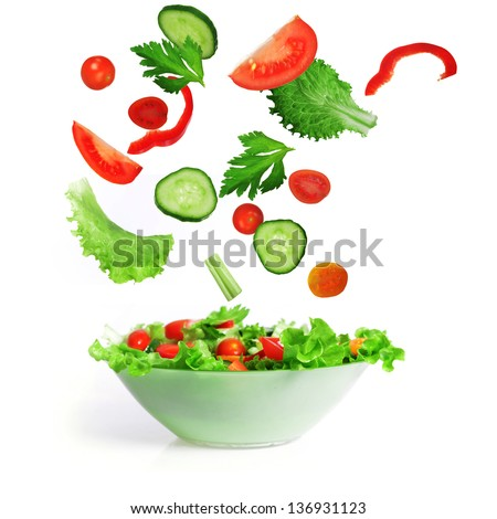 salad with lettuce and other fresh vegetable on white dish.