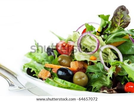 Salad with lettuce, carrot, croutons, olive, tomato, onion...
