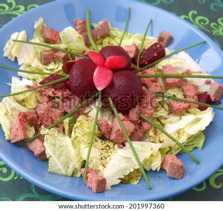 Salad with liver and red beetroot