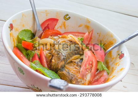 Salad with mackerel in tomato sauce