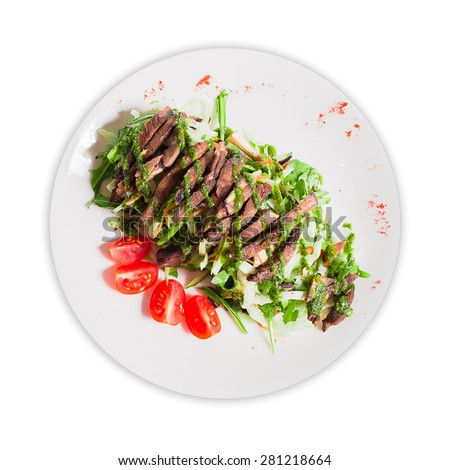 Salad with meat and vegetables on a plate - stock photo