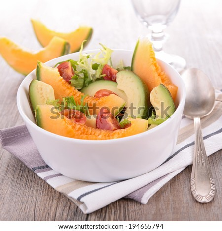 salad with melon and avocado - stock photo