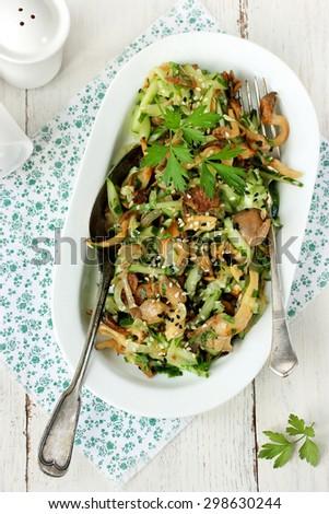 Salad with mushroom, cucumber, sesame seeds and herbs - stock photo