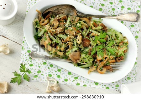 Salad with mushrooms and cucumber on a white background - stock photo