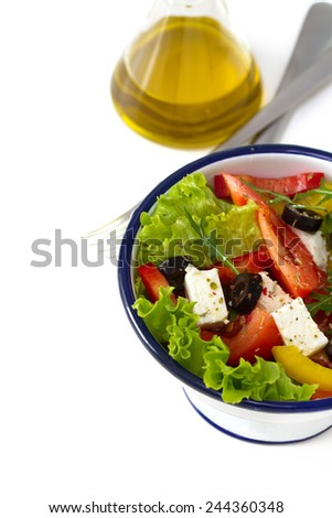 salad with oil on white background - stock photo