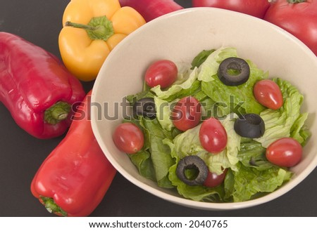Salad with olives and tomatoes - stock photo
