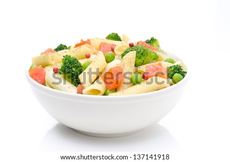 salad with pasta, smoked salmon, broccoli and green peas in a bowl isolated on a white background - stock photo