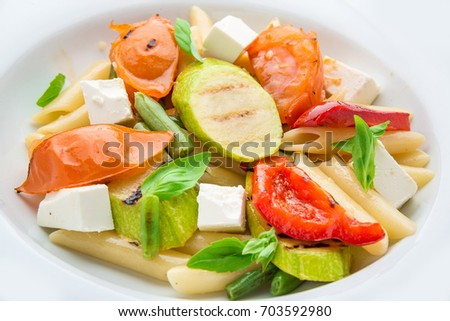 Salad with pasta,vegetables and feta on the plate
