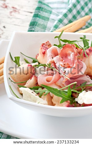 Salad with peach, mozzarella cheese and ham - stock photo