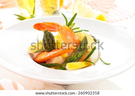 Salad with prawns, quail eggs asparagus and lemon.  - stock photo