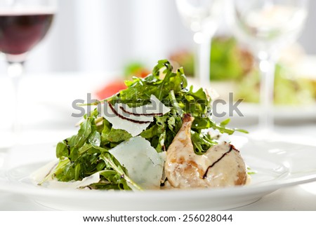 Salad with Quail Wings and Parmesan Cheese - stock photo
