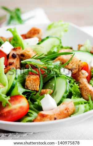 Salad with roasted chicken, tomatoes and feta - stock photo