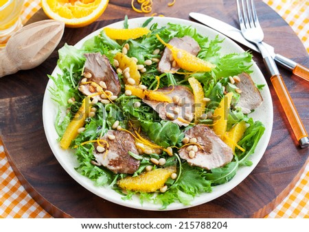 Salad with roasted duck breast and orange - stock photo