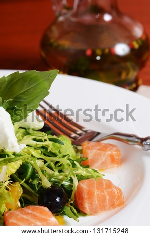 Salad with salmon and mascarpone cheese, pomelo leaves and lettuce. The restaurant dish - stock photo