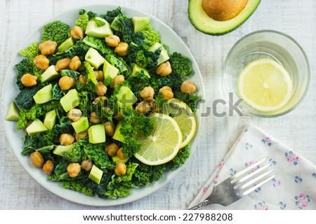 Salad with savoy cabbage, avocado and chickpeas, top view - stock photo