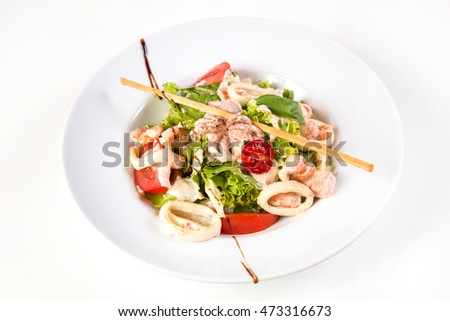salad with seafood and vegetables isolated on white background