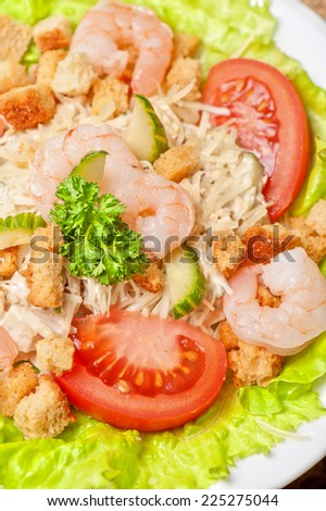 salad with shrimp, vegetables and crackers - stock photo
