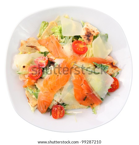 salad  with slices of salmon, cherry tomatoes, greens and pitta bread in a white dish isolated on a white background. Top view. - stock photo