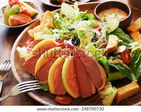 Salad with Smoke-cured Duck Breast and Cheese - stock photo
