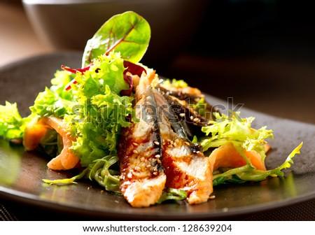 Salad With Smoked Eel. Japanese Food - stock photo