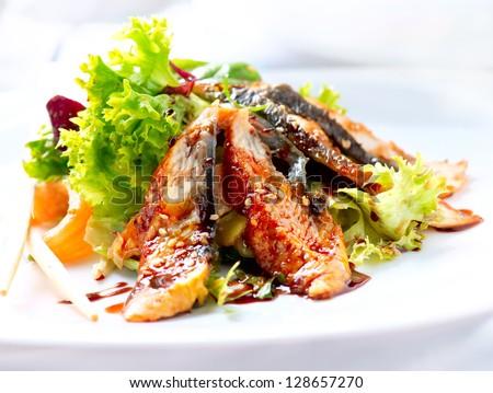Salad With Smoked Eel with Unagi Sauce. Japanese Food - stock photo