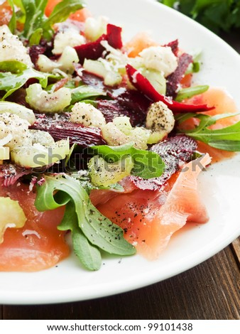 Salad with smoked salmon, herbs, celery and parmesan. Shallow dof. - stock photo