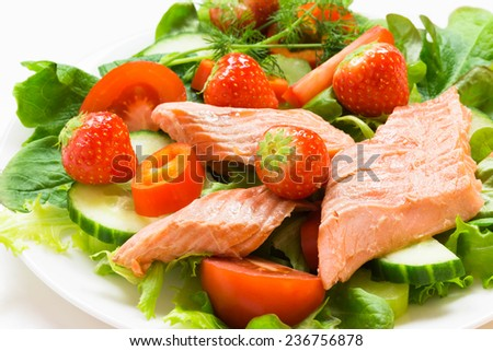 salad with smoked salmon with strawberries and dill on white background - stock photo