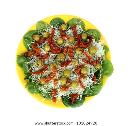 salad with sun dried tomatoes, olives, sprouts, spinach leaves