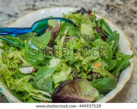 Salad with sweet, crunchy candied walnuts sprinkled on leafy greens