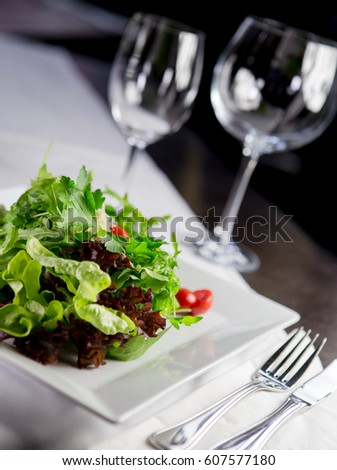 salad with tomato and bread in highclass restaurant